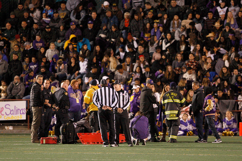 . The crowd stands in silence as paramedics tend to injured Salinas High running back Mike Cortez (41) who sustained an injury in the second half of their Division 4-AA CIF State Football Championship Bowl Game against Placer High on Friday, Dec. 8, 2017 in Salinas.  Placer High beat Salinas High in overtime 43-42 to advance to the CIF State Final.  (Vern Fisher - Monterey Herald)