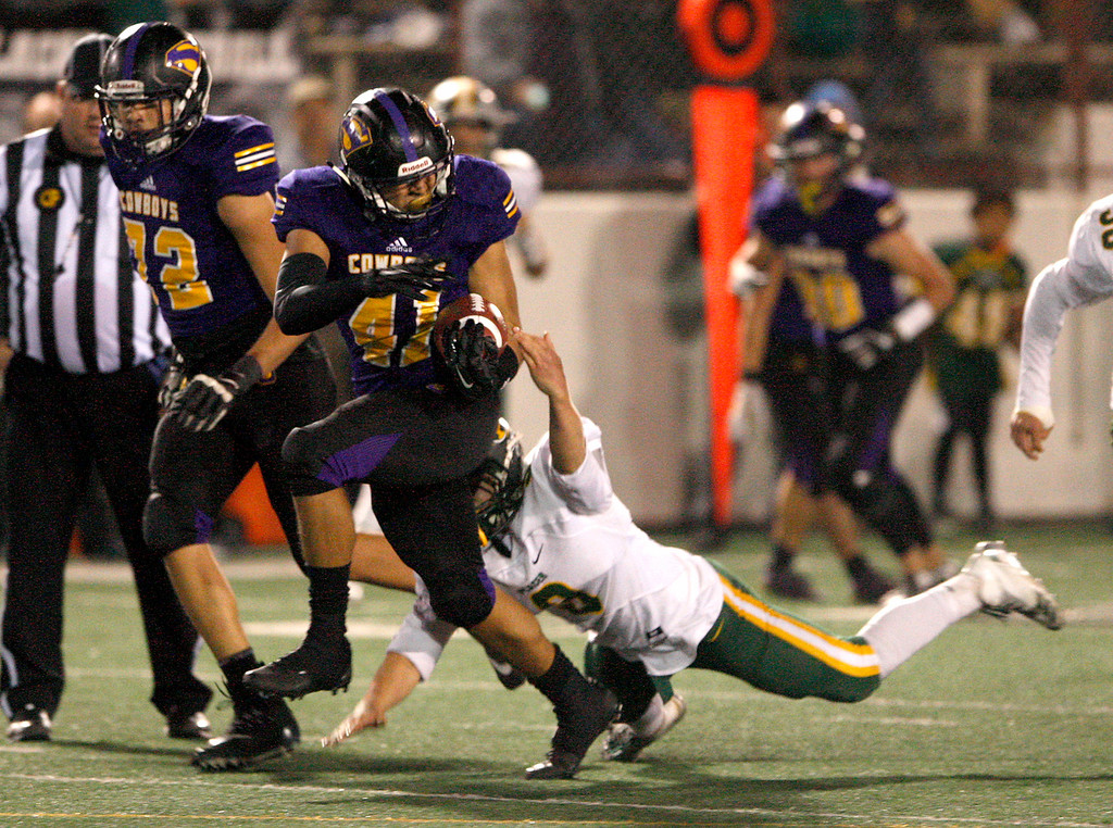 . Salinas High running back Mike Cortez (41) breaks free from Placer High\'s Ryan Arnel (8) in the second half of their Division 4-AA CIF State Football Championship Bowl Game against Placer High School on Friday, Dec. 8, 2017 in Salinas.  Placer High beat Salinas High in overtime 43-42 to advance to the CIF State Final.  (Vern Fisher - Monterey Herald)