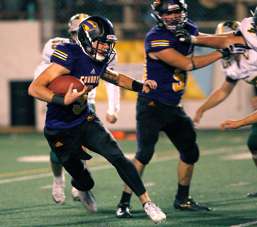 . Salinas High quarterback Brett Reade (9) scrambles for yards in the second half of their Division 4-AA CIF State Football Championship Bowl Game against Placer High School on Friday, Dec. 8, 2017 in Salinas.  (Vern Fisher - Monterey Herald)