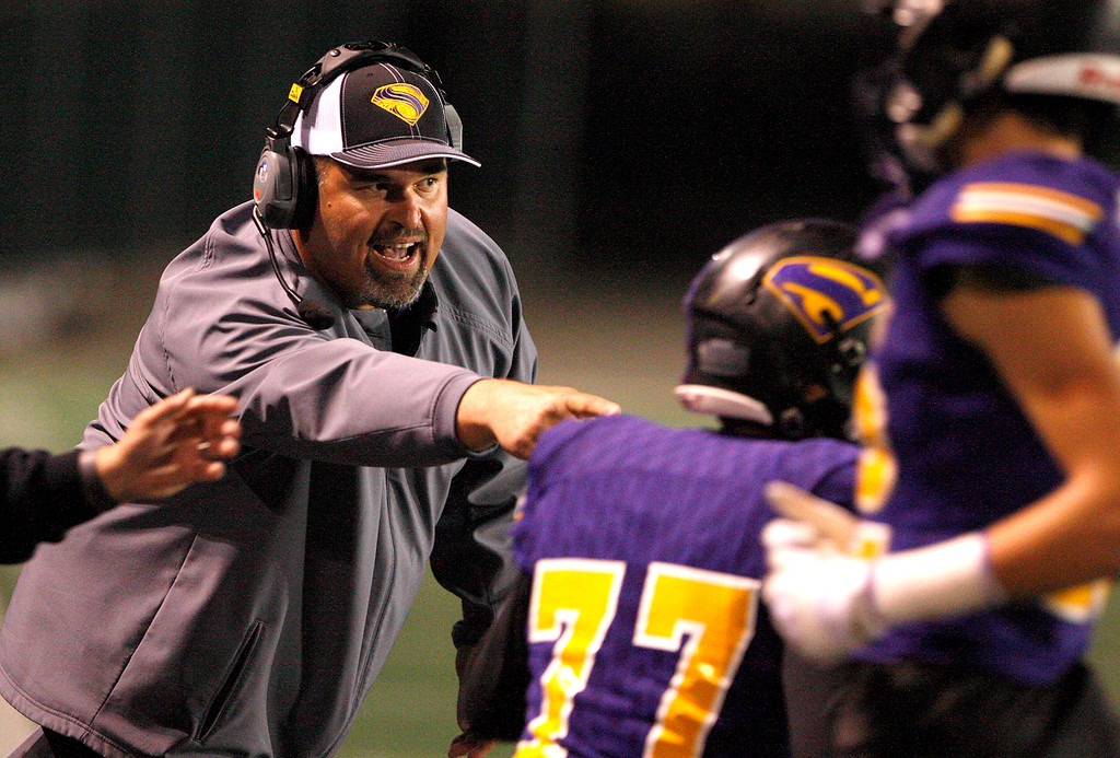 . Salinas High head coach Steve Zenk instructs his players in the first half of their Division 4-AA CIF State Football Championship Bowl Game against Placer High School on Friday, Dec. 8, 2017 in Salinas.  (Vern Fisher - Monterey Herald)