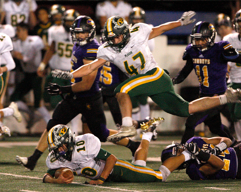 . Placer High\'s Marshall Chapman (10) is tackled as teammate Louis Fudge (47) soars over the play in the second half of their Division 4-AA CIF State Football Championship Bowl Game on Friday, Dec. 8, 2017 in Salinas.  Placer High beat Salinas High in overtime 43-42 to advance to the CIF State Final.  (Vern Fisher - Monterey Herald)