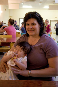 Julia chowing down inside the community hall in Tway