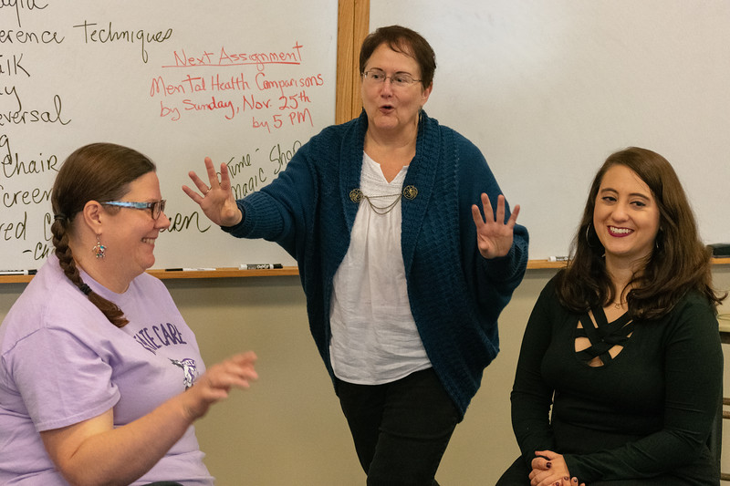 Sally Bailey, a professor in theatre, director of graduate studies in theatre, and director of the drama therapy program helps students practice improv skits in her Monday afternoon class. Professor Bailey has taught numerous courses at K-State including, principles of drama therapy, drama therapy with special populations, creative dramatics, workshop in playwriting, creative arts therapies, and drama therapy practicum. (Brooke Barrett | Collegian Media Group)
