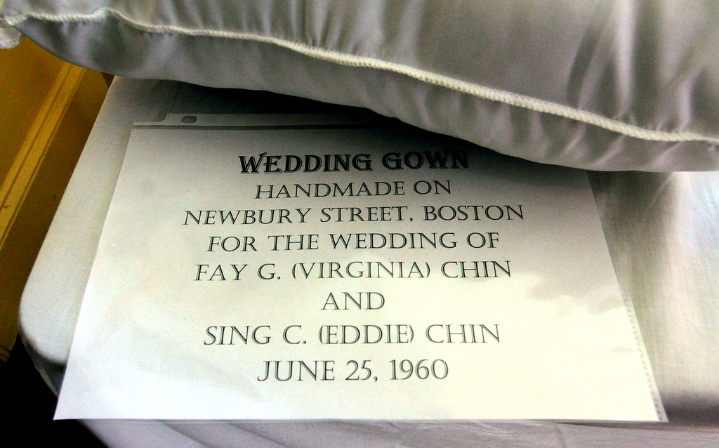 """. Sign for the wedding dress of Fay G. \""""Virginia\"""" Chin 78 of Chelmsford, on display at the Garrison House. SUN/David H. Brow"""