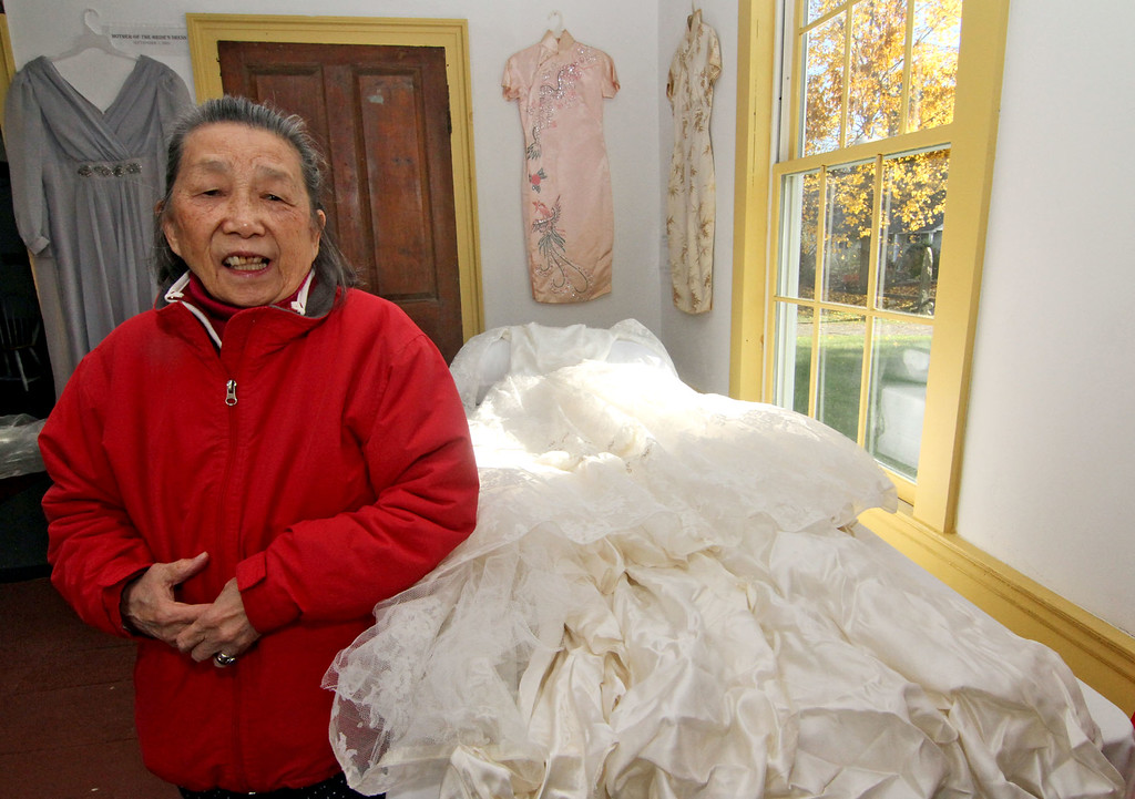 """. Fay G. \""""Virginia\"""" Chin, 78, stands next to her wedding dress from 1960, on display at the Garrison House in Chelmsford. SUN/David H. Brow"""