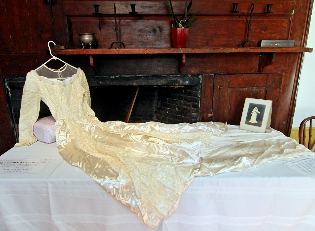 . On display at the Garrison House in Chelmsford is this wedding dress of Elizabeth M. Postupack who was married to George A. Ripsom on May 8th, 1954. SUN/David H. Brow