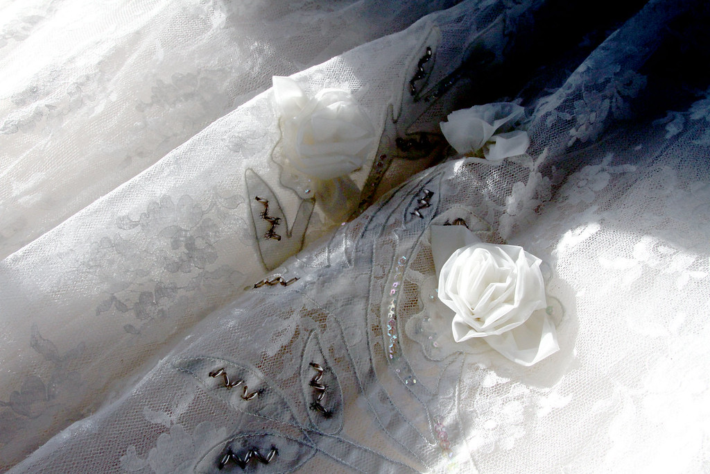 """. Close up of the detail on the wedding dress of Kay G. \""""Virginia\"""" Chin of Chelmsford, on display at the Garrison House. SUN/David H. Brow"""