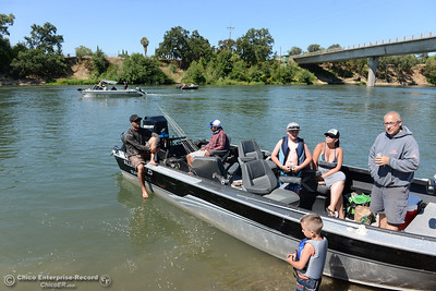 Fishing guide John Pearl, left, plans on taking the Ortiz family back out to try for striped bass in the evening. Anglers report the salmon aren't biting on opening day, Saturday, July 16, 2016, on the Sacramento River at Woodson Bridge State Recreation Area in Corning, California. (Dan Reidel -- Enterprise-Record)