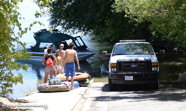 Not everyone on the water Saturday, July 16, 2016, is an angler. A group of tubers waits for the Butte County Sheriff's Office patrol boat to clear the Irvine Finch boat launch in Hamilton City, California. (Dan Reidel -- Enterprise-Record)