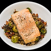 Salmon with bacon Brussels sprouts and quinoa rice