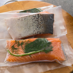 Vacuum sealed salmon with dill