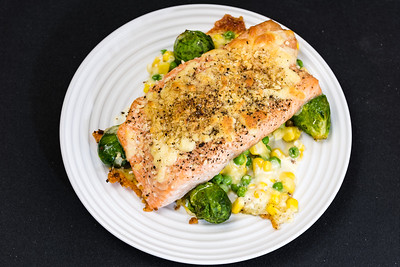 Salmon and cheesy vegetables