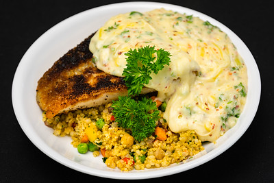 Salmon with pearl barley couscous and white sauce