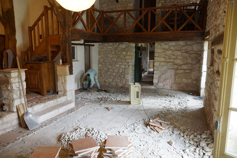 We started with the lower level.  Removed bookshelves and lifted old tile, most of which we recovered intact.