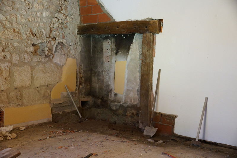 The corner now roughly squared off and the brick wall secured.