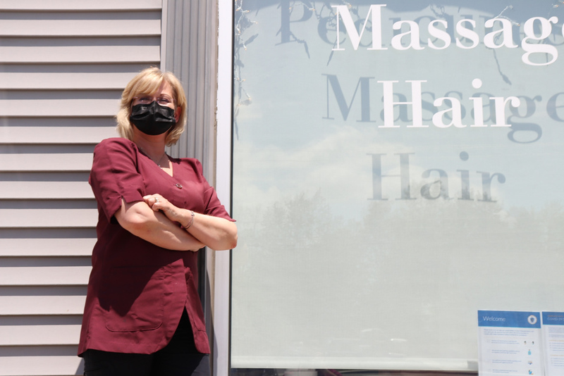 Vicki Manchester, owner of Fitchburg's Hey Good Look'n Salon and Spa, said she's hopeful for her business after opening Monday. Sentinel and Enterprise/Daniel Monahan