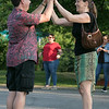 Salsa on the Riverfront is a monthly event series bringing free beginner salsa dance lessons and social dance to downtown Fitchburg at Riverfront Park. July 26, 2019 was the second one of the summer. Kathy Antoniou of Webster high fives Joe Bowen of Fitchburg after they practices some steps during the class. SENTINEL & ENTERPRISE/JOHN LOVE