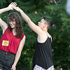 Salsa on the Riverfront is a monthly event series bringing free beginner salsa dance lessons and social dance to downtown Fitchburg at Riverfront Park. July 26, 2019 was the second one of the summer. Kayla Bertucci of Fitchburg, on left, helps instructor Marissa Monteiro teach the class a spin move.  SENTINEL & ENTERPRISE/JOHN LOVE