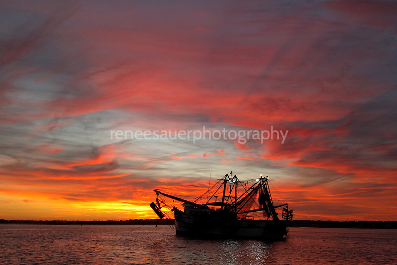 banks channel sunset with a shrimper