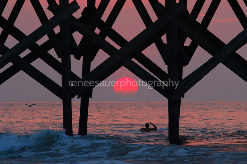 pink sunrise under crystal pier in wb