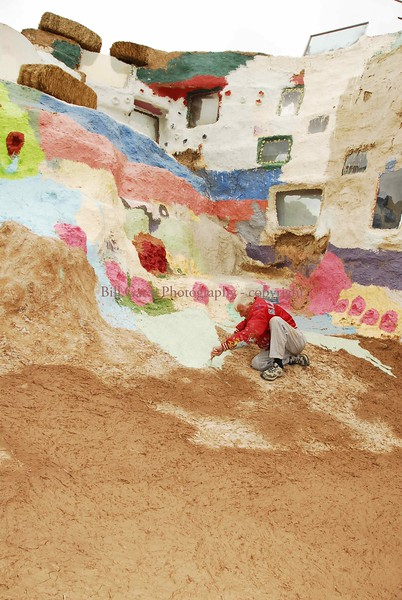 Leonard Knight painting his Salvation Mountain