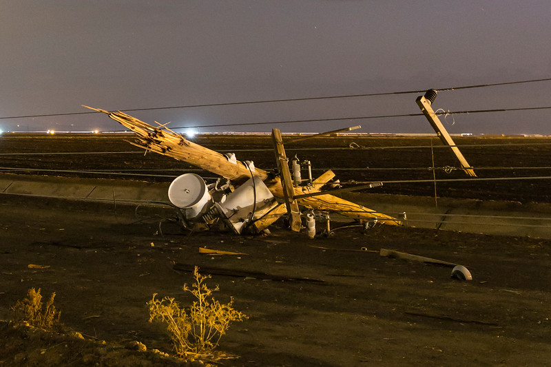 Strong winds knocked down power lines along Gentry Road in Calipatria, California.