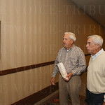 Bob Meyer and Bill Bell watched game footage from past St. X-Trinity games.