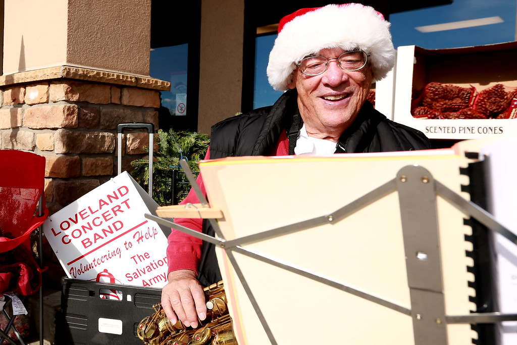 . Buzz Zaiger from the Loveland Concert Band prepares to play his saxophone outside of the Orchard King Soopers to help The Salvation Army collect donations on Dec. 1, 2018 in Loveland, Colo.Photo by Taelyn Livingston/ Loveland Reporter-Herald