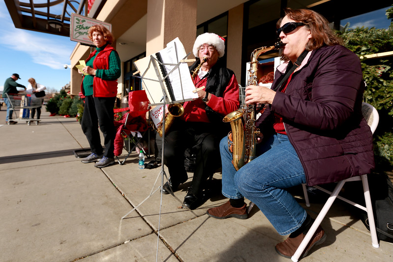 Lee DeSimone stands in front of the Orchard King Soopers next to Buzz Zaiger and Kathy Gustad from the Loveland Concert Band as they collect donations for The Salvation Army on Dec. 1, 2018 in Loveland, Colo.<br /> Photo by Taelyn Livingston/ Loveland Reporter-Herald