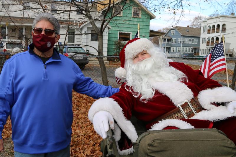 Fitchburg Mayor Steve DiNatale greets Santa Claus.