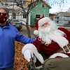 Fitchburg Mayor Steve DiNatale greets Santa Claus.