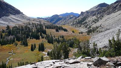 The beautiful alpine basin falls away below us.