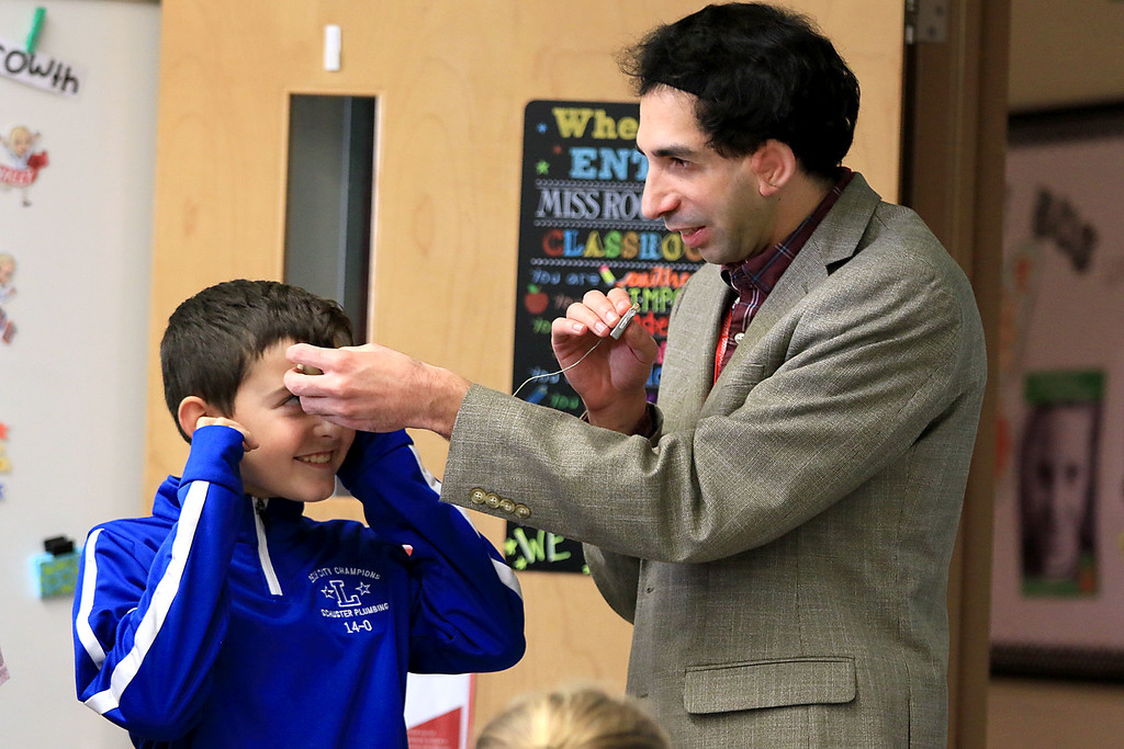 . Johnny Appleseed Elementary School had motivational speaker Sam Drazin the executive director of Changing Perspectives a company that is promoting awareness and inspiring empathy out of Bradford Vermont in to speak to the students and help them except people that are different. Drazin let a few of the kids try out his hearing aid. Here fourth grader Richard Barnaby tries it out so he could see how Drazin hears things differently then most people. SENTINEL & ENTERPRISE/JOHN LOVE