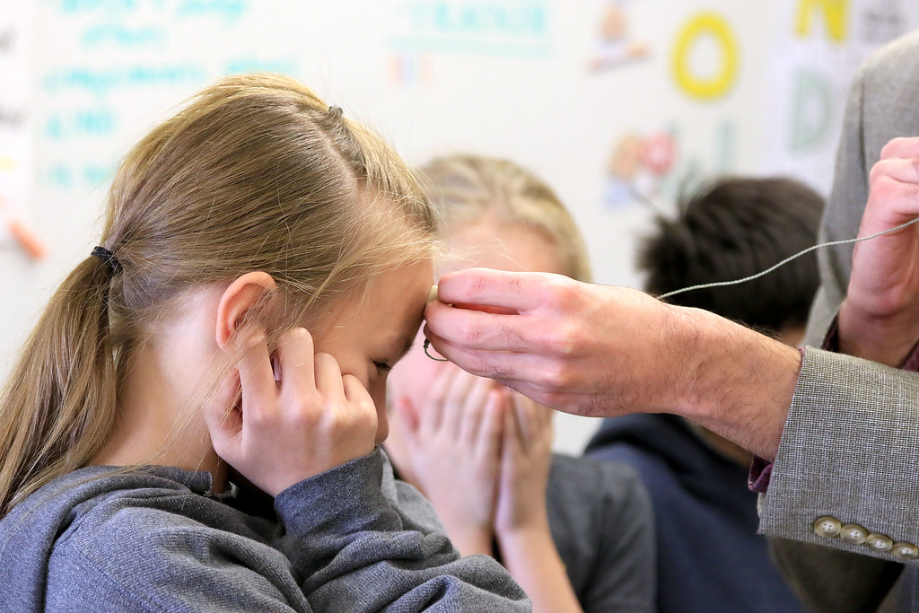 . Johnny Appleseed Elementary School had motivational speaker Sam Drazin the executive director of Changing Perspectives a company that is promoting awareness and inspiring empathy out of Bradford Vermont in to speak to the students and help them except people that are different. Drazin let a few of the kids try out his hearing aid. Here fourth grader Grace Martin tries it out so she could see how Drazin hears things differently then most people. SENTINEL & ENTERPRISE/JOHN LOVE