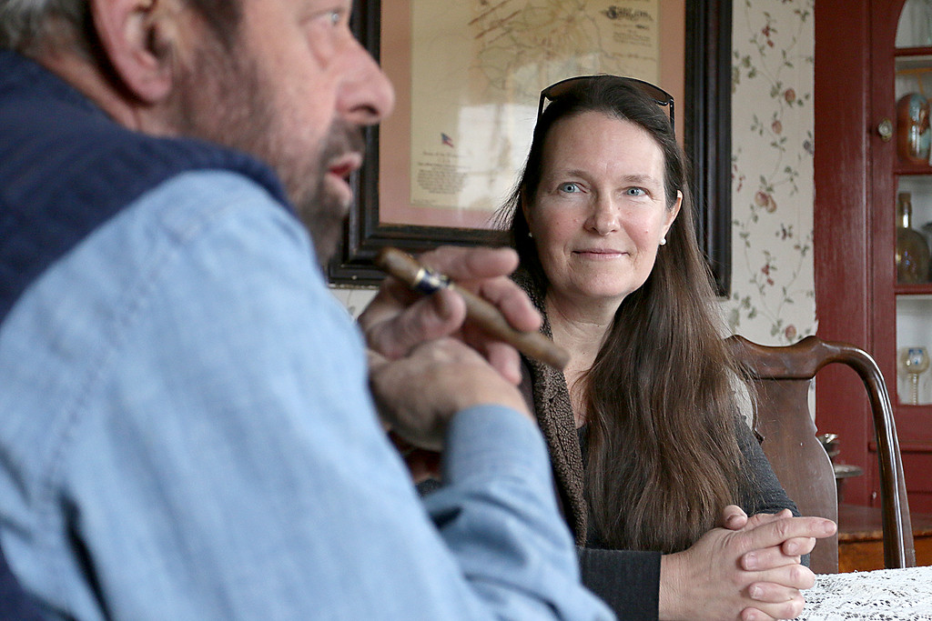 . Julie Grant listens to her husband Sam Grant as he talks about how they re-enact Gen. Ulysses S. Grant and his wife at their home in Townsend MA on Tuesday afternoon. SENTINEL & ENTERPRISE/JOHN LOVE