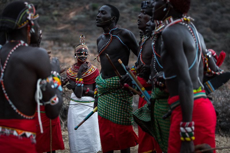 Young Samburu women and warriors dancing at sundown.