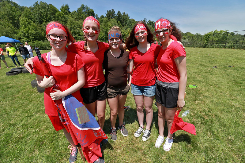 Samoset Middle School seventh graders held a Greek Olympics at the school on Tuesday morning with eight teams. Holding the flag for his team the Spartans is Ethan Carr, 13. Posing for a picture is seventh graders, from left, Mya Dunn, Katie Packard, Samantha Cook, Samantha Modica and Amal Elkhoury.  SENTINEL & ENTERPRISE/JOHN LOVE