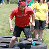 Samoset Middle School seventh graders held a Greek Olympics at the school on Tuesday morning with eight teams. Running a tire course is seventh grader Tony Salvatelli. SENTINEL & ENTERPRISE/JOHN LOVE