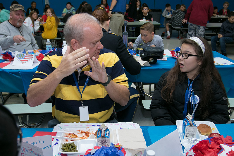 The Samoset Middle School held for the eleventh year the Bring a Veteran To Lunch in honor on Veterans Day Friday, Nov. 8, 2019. Michael Gaynar, who was in the Army Reserves, chats with sixth grader Nevaeh Martins, 11, as they have lunch together during the event. SENTINEL & ENTERPRISE/JOHN LOVE