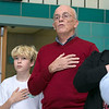 The Samoset Middle School held for the eleventh year the Bring a Veteran To Lunch in honor on Veterans Day Friday, Nov. 8, 2019. Singing along to the national anthem is Navy veteran Bob Young with his grandson seventh grader Julian Stopyra, on left. SENTINEL & ENTERPRISE/JOHN LOVE