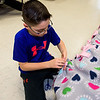6th grader Zachary Macleod pieces together a no-sew blanket for Health Alliance Hospitals during a 2 hour service workshop held at the Samoset Middle School in Leominster on Friday Dec. 23, 2016. (Sentinel & Enterprise photo/Jeff Porter)