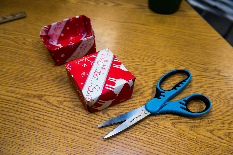 Finished origami boxes sit on a table inside one of the classrooms participating in a 2 hour service workshop at the Samoset Middle School in Leominster on Friday Dec. 23, 2016.  (Sentinel & Enterprise photo/Jeff Porter)