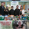 Samoset Middle School held their annual food drive and donated what they collected to the Hillary A. Bartlett Newsome Foundation on Thursday, Dec. 19, 2019. From left is Nick Bartlett with the foundation, with eighth graders Mary Analeemuna, 13, Giovani Valeri, 3, Jacob Russell, 13, who helped head up the collecting of the food at the school with English Language Arts teacher Katelyn Henrie. SENTINEL & ENTERPRISE/JOHN LOVE
