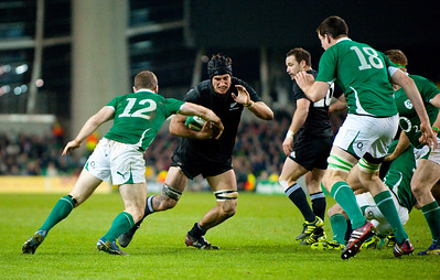 Tom Donnelly evades Gordon D'Arcy. During the International rugby test with Ireland against the New Zealand All Blacks at Aviva Stadium Dublin. November 2010