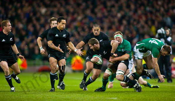 Kieren Read evades Tommy Bowe and is tackled by Tom Court with Hosea Gear and Cory Jane looking on. During the International rugby test with Ireland against the New Zealand All Blacks at Aviva Stadium Dublin. November 2010