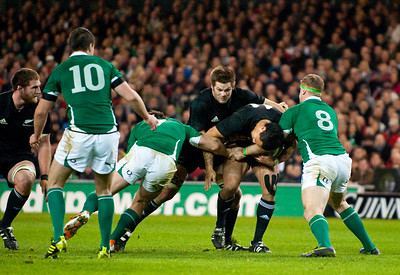 Hosea gear is tackled by David Wallace and Jamie Heaslip whilst Richie McCaw lending a hand and Kieran Read and Jonathon Sexton looking on. During the International rugby test with Ireland against the New Zealand All Blacks at Aviva Stadium Dublin. November 2010