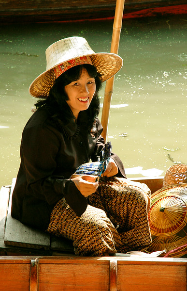 Hat Vendor<br /> Floating Market<br /> Damnoen Saduak, Ratchaburi