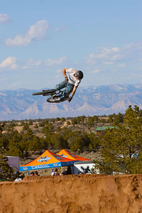 Ranch Style Dirt Jump Contest with the Grand Junction Mountains as a back drop.