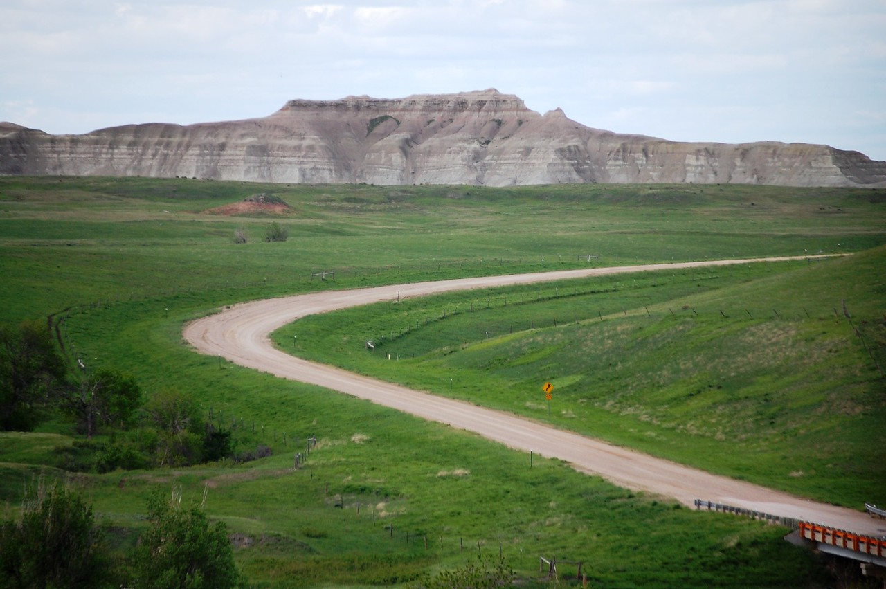 Gravel Road (SD 63) heading north to Belvidere, South Dakota with Badlands in the background
