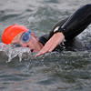 Open swim during a triathlon event where a long lens is required to get in close from the bank.